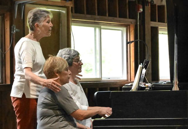 Piano teacher Nancy Breth coaches Susan and Barbara as they prepare the Andante from Schubert's Grand Duo.